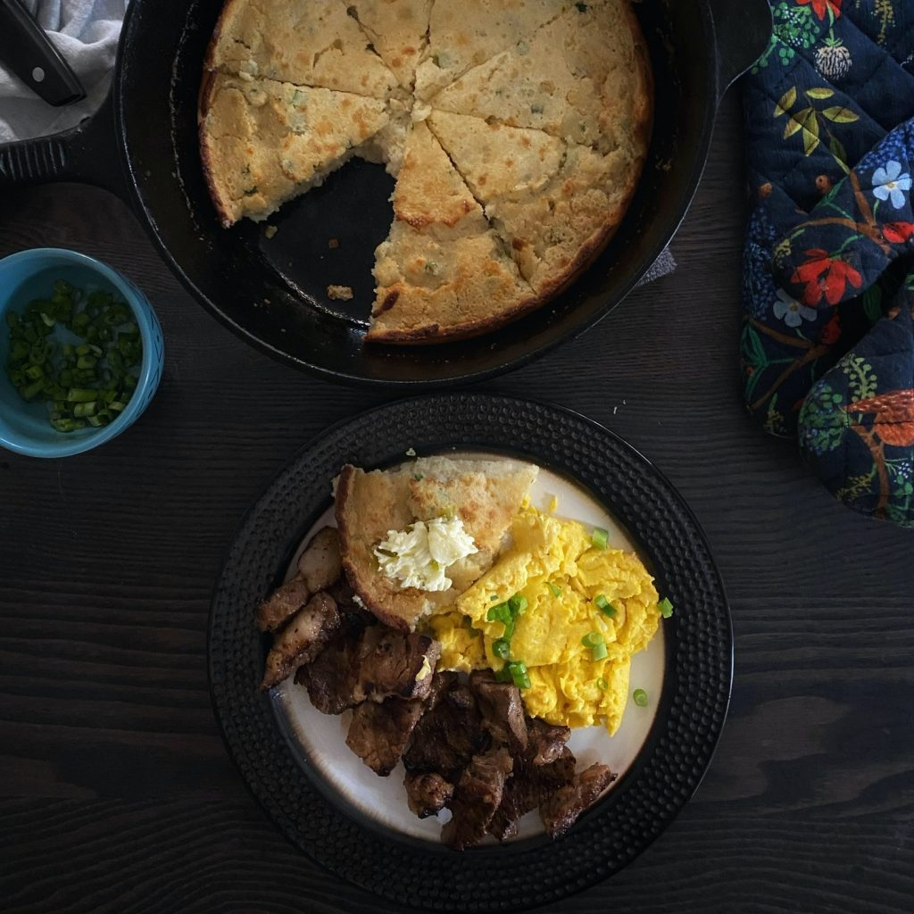 Steak and Cheesy Eggs with Skillet Corn Cake and Jalapeño Butter